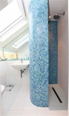 Curved tiled shower wall.. yeah. unlikely.. but interesting.