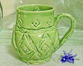 Love this green pottery mug!  http://www.etsy.com/treasury/OTgxMjA1MnwyNzIyNjgzMTg4/state-of-wonder?ref=pr_treasury