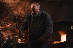 Blacksmith working at his workshop