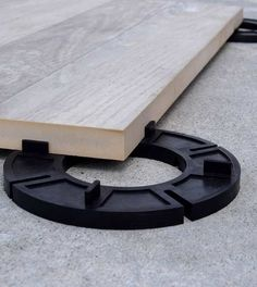 Elevated rooftop decks using porcelain pavers, interlocking deck tiles, structural wood deck tiles, outdoor flooring for terraces, patio decks with deck tiles and pedestal paver systems.