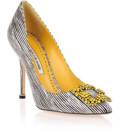 """Black and white striped embossed leather pump with a yellow crystal embellished ornament from Manolo Blahnik. The Hangisi pump has a slightly pointed toe, a heel measuring approximately 105mm / 4"""" high, and yellow leather lining.True to sizeLeather soleMade in ItalyDesigner colour: Yukon #manoloblahnikheelscolour #manoloblahnikyellow #manoloblahnikhangisi"""