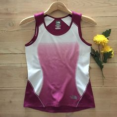 | The North Face Flight Series Top Plum and cream flight series with vaporwick  workout tank top.  One tiny snag on back near hem - not noticeable unless looking very closely. Otherwise in excellent, gently used condition. The North Face Tops Tank Tops