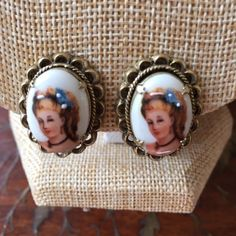Vintage girls face on ceramic clip-on earrings Unable to read inside what name inside. Vintage cameo look (painted) clip-on earrings. Very pretty girls face. Unk Jewelry Earrings