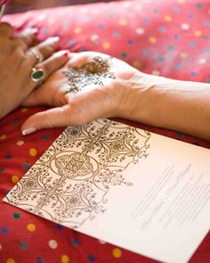 Modern, simple invitation with henna design