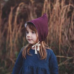 Wanna hear people ooh and ah over your lovely babe? This hat will help set off her beautiful eyes and face. Adorable pixie bonnet made in a gorgeous shade of plum and reversible with a linen/rayon blend on one side and cotton flannel on the other. This pixie bonnet is a stunner in real