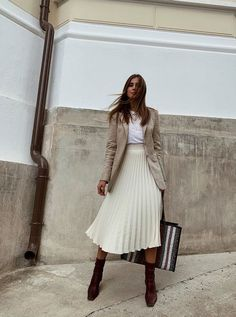 Affordable autumn outfits: beige blazer with pleated midi skirt and sock boots
