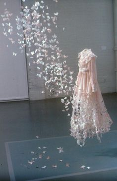 Are the flowers flowing in or out of the dress?