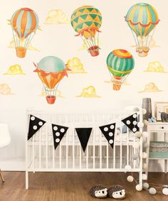 Our Up & Away Hot Air Balloon Watercolor Wall Decal Kit creates adventure, color and whimsy in any room. This kit includes 5 Hot Air Balloons and 7 puffy clouds , all Illustrated in Watercolor and Ink