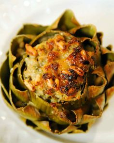 Put fresh spring artichokes to good use with this simple, savory recipe from Osterio Del Circo chef Michael Galata. Serve with his Roast Leg of Lamb for an elegant Easter meal. Appetizer Recipes, Appetizers, Easter Recipes, Stuffed Artichokes, Roasted Artichokes, Cooking Recipes, Healthy Recipes, Vegetable Side Dishes, I Love Food