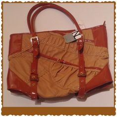 OFFER&CLICK FASHION FORWARD A NICOLE LEE FOR YOU SOLD AS IS.          1 BELT LOOP MISSING IS CONSIDERED IN PRICE...THE EVER SASSY FAUX LEATHER WITH PATENT LEATHER BLEND   NICOLE LEE  IS NOTED FOR TOP QUALITY & DETAILED CRAFTSMANSHIP BURNT ORANGE AND TAN. Nicole Lee Bags
