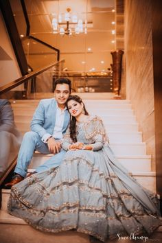 Candid Couple Shot - Bride in a Powder Blue Lehenga with Golden Detailing and Groom in a Blue Suit | Photo by: Savi Bhangu Photography #wedmegood #indianbride #indianwedding #bridallehenga #lehenga #powderblue #suit #weddinglehenga