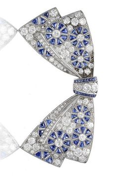 A sapphire and diamond bow brooch, circa 1920. The double bow pavé-set with old brilliant, brilliant, single and rose-cut diamonds, with finely pierced wheel motifs decorated with triangular-cut sapphire spokes, further calibré-cut sapphire detail at the centre, delicate millegrain detail throughout, mounted in platinum, engraved with ownership mark of the letter 'M' beneath The Princess Margaret's coronet. From the Collection of Her Royal Highness The Princess Margaret, Countess of Snowdon.
