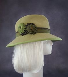69242040 Wide-brim women's hat with origami ribbon flower cockades. By