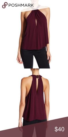 """Free People Twist & Shout Tank Free People Twist & Shout TanK Size: small Color wine Details - Halter neck - Sleeveless - Back adjustable buckle closure at nape - Front crisscross strap detail - Front and back keyhole cutouts - Approx. 27.5"""" length - Imported Fiber Content 100% rayon Care Machine wash cold Additional Info Fit: this style fits true to size.  Model's stats for sizing: - Height: 5'9"""" - Bust: 34"""" - Waist: 25"""" - Hips: 35"""" Model is wearing size S. Free People Tops Blouses"""
