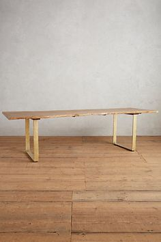 Talked about changing the brass color to darker. loving the shape of the wood top and the wood table top is complimentary to your existing wood floors. Smoked Oak Dining Table #anthropologie