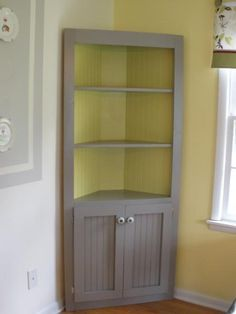 Cute corner cabinet! | Do It Yourself Home Projects from Ana White- perfect in middle room! use as book shelves or display shelves for china. Follow me on twitter @fernanmedequill