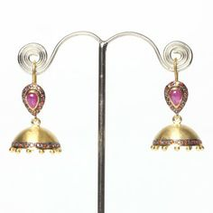 These jhumkis are made from sterling silver and gold pdusted, and feature uncut ruby at their heart, surrounded by several dazzling garnet s...