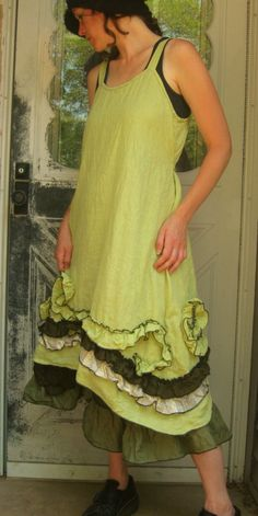 Light yellowish green ruffle and swirl dress, a-line with ruffle and swirls all along the bottom, sides dip longer than the center! Ties in
