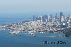Breathtaking view of San Francisco, including Pier 39, and the Aquatic park. Other icons like the Transamerica building, coit tower, and Bay bridge can also be seen.
