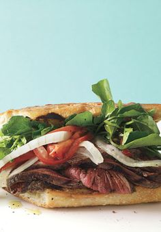 // Grilled Steak Sandwiches with Marinated Watercress, Onion, and Tomato Salad