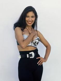 Selena Quintanilla! Bustier and ridin them jeans highhh girl. Worrrk