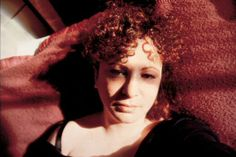 Nan Goldin, self-portrait with eyes turned inward 1989