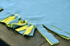 Use patterned material with solid color for contrast.  No-sew blanket instructions so easy