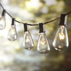 String lights are synonymous with party lights. Use string lights to illuminate food and drink areas, or to light an open space for dancing. They also look cool wrapped around tree trunks, deck railings or even trellises for an unexpected focal point. Add a bit of vintage flair with Edison bulb string lights or mercury ball string lights draped from a gazebo or pergola.