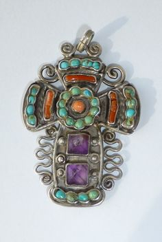 Vintage Matl Matilde Poulat Mexican Sterling Silver, Coral, Amethyst Turquoise Cross Pendant $350.00. Even though I love this type of jewelry and own a few pieces I've never understood why its so expensive.