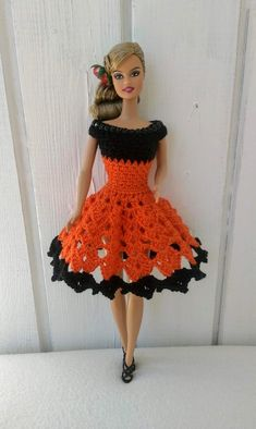 Handmade dress for Barbie doll by my own design. Crocheted dress made of orange cotton yarn in combination with a black cotton yarn. Doll and shoes is NOT included. Barbie Knitting Patterns, Knitting Dolls Clothes, Crochet Dolls Free Patterns, Barbie Patterns, Doll Clothes Patterns, Clothing Patterns, Doll Fancy Dress, Crochet Doll Dress, Crochet Barbie Clothes