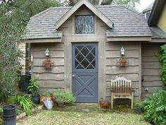 Potting shed with a swing door and wonderful rustic touches.