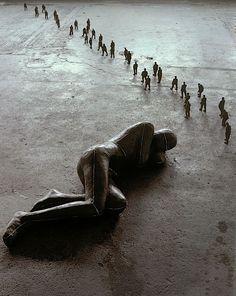 Antony Gormley. Man Asleep, 1985. Lead, Plaster, Fibreglass, Air, Teracotta. Large figure: 50 x 185 x 63; Small figures overall: 14 x 600 x 30.