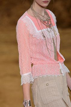 Chanel. even though most people won't ever be able to own Chanel, look to the colors, fabric textures and accessories to closely recreate the look.
