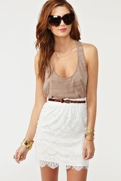 Dreamy white lace skirt featuring a high waist and scalloped fringe hem