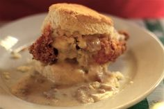 The Big Nasty Biscuit at Hominy Grill in Charleston, SC.  Fried chicken breast on a high-rise biscuit with melted cheddar cheese AND smothered in sausage gravy.  Heart attack?  Yes, but totally getting one of these during my upcoming visit!