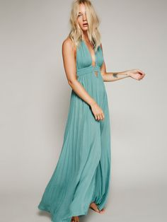 Look Into the Sun Maxi | Sun goddess maxi in a crinkly crepe with a deep V-neck, adjustable rope halter, and stretchy smocked empire waist with geo cutout detailing below. Raw edges. We love tying the slit, and creating a knotted hem to change up the look.