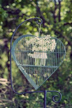 Southern Vintage Wedding Rental- birdcages different sizes and shapes and 2 stands