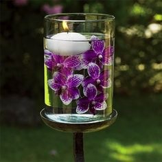 Orchids in water with floating candles.love this but with blue orchids! Silk Flower Centerpieces, Purple Wedding Centerpieces, Candle Centerpieces, Flower Arrangements, Wedding Decorations, Purple Centerpiece, Centerpiece Ideas, Simple Centerpieces, Table Decorations