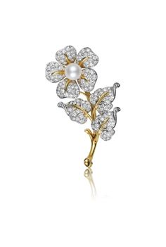 A Tiffany & Co. Diamond and Cultured Pearl Flower Brooch. Designed as a pavé-set diamond flower, centering on a cultured pearl, extending a polished gold stem and pavé-set diamond leaves, mounted in platinum and 18K yellow gold.