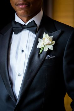 Glamorous Chicago Wedding by Ann & Kam Photography. To see more: http://www.modwedding.com/2014/09/01/glamorous-chicago-wedding-ann-kam-photography/#!prettyPhoto #wedding #weddings #wedding_boutonniere