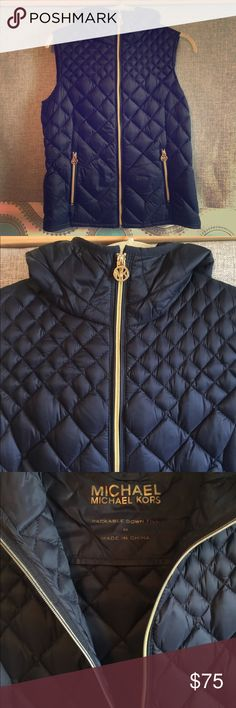 """Michael Kors Navy Blue Puffer Vest Navy blue Michael Kors down filled puffy vest, hooded, women's size medium. The zipper is gold and the zipper pulls have the """"MK"""" gold color logo. Absolutely perfect condition! Michael Kors Jackets & Coats Vests"""