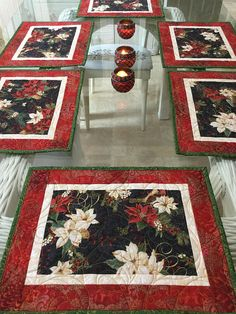These quilted Placemats are perfect for your table for the Holidays, they have beautiful poinsettias in white and red, red berries, pine cones that make them very festive. They are quilted in a swirly design with Holly leaves and berries, it totally compliments what I had in mind. They are sold in sets of 2, that way you can choose if you need 4,6,or 8, if by chance you need more than that you can send me a note. They measure 17 1/2 X 13 1/2, Machine washable on gentle cycle no blea...