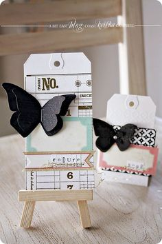 black butterflies on shipping tags