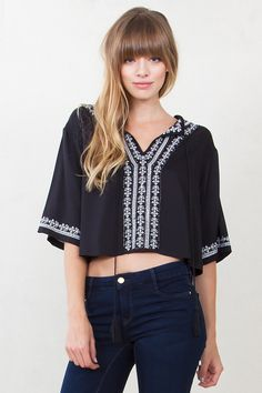 Dahlia Embroidered Top*  This three quarter sleeve top creates an effortless bohemian look. White embroidery details and a self tie closure on the front complete the top. Pair with your favorite skinnies and booties.  Free shipping. Free returns.