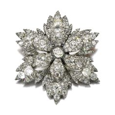DIAMOND BROOCH, EARLY 19TH CENTURY Estimate: 4,000 - 6,000 GBP  LOT SOLD. 21,250 GBP  (Hammer Price with Buyers Premium) Designed as a flower head, the centre seten tremblent, with cushion-, pear-shaped and circular-cut diamonds, later brooch fitting.