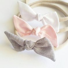 Set of three of our bitsy knot bows. Graystone, white and pink. Each bow comes on soft nylon headband. One size fits all. Each bow is appx 3 inches in length. Perfect for newborn-toddler. Hand sewn and tied with love! Prefer a clip? Leave a note at checkout.  To see our entire selection of hair accessories and handmade apparel please visit our Etsy Shop!  www.lavenderparade.etsy.com  Find us on Instagram! @lavenderparade www.instagram/lavenderparade.com