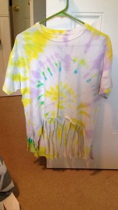 Tie die shirt cut in the front and back in slips