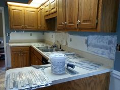 Painted the Kitchen now fixing to lay glass mosaic tile for a backslash