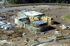 A rare construction photo of the France Pavilion in Epcot. In foreground is the promenade and wall for the lagoon.