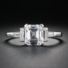 For a very simple simple ring I really like it. As close to a solitaire as I'd get.  Image from http://www.langantiques.com/images/external/26960/1362609511_10_1_5701_Carat_E_Internally_Flawless_Emerald_Cut_Diamond_Art_Deco_Engagement_Ring__1_of_5_.jpg.